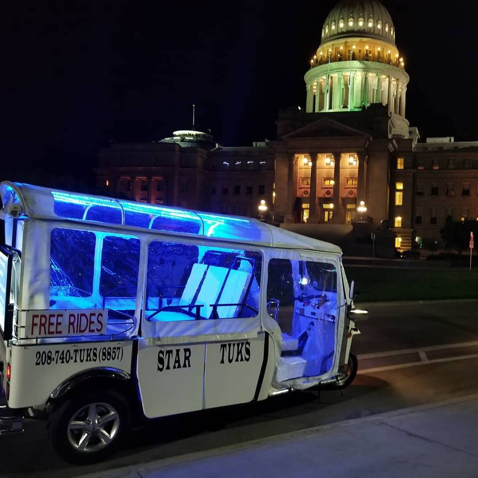 Star Tuk in front of the Boise Capitol building